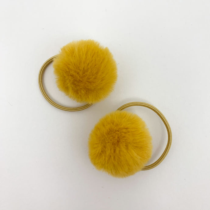 Girls hair accessories for pigtails and hair styles. Baby and toddler pompom bobbles in a variety of colours. Fluffy pompom bobbles on an elasticated band for little girls hairstyling. Bel Bambini baby boutique.