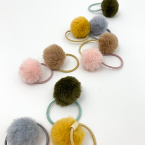 Shop our exclusive range of baby hair accessories, including our fluffy pompom bobbles with an elasticated band. Toddler hair bobbles with fluffy pompoms.