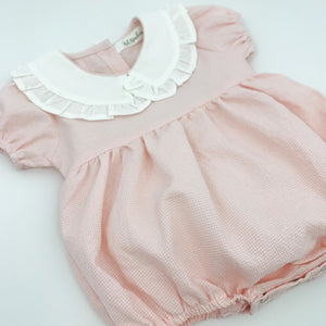 Baby girls rompersuit in pink. Frill collar and puff sleeves with a gathered waist.  Baby and toddler rompers for girls aged 0-2 years.