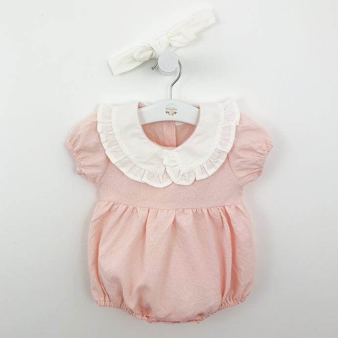 Pretty in pink baby girls frill collar romper. A swett little outfit complete with a white headband. Gingham print and puff sleeves. Gathered at the waist making this is beautiful style for girls aged 0=24 months. Shop our baby collections online at Bel Bambini baby boutique.