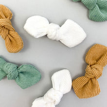 Load image into Gallery viewer, Toddler hair accessories, baby hair clips. Three bow clips for baby and toddlers hair in  beautiful shades. Spring summer hair clips for little girls. Mustard, white and soft mint come together in a set of hair clips.