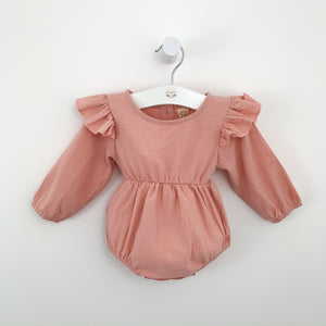 Baby girls romper with frilly flutter shoulder details. Long sleeved romper for girls in a beautiful shade of pink. Pink girls romper. Bel Bambini rompers for toddlers and baby girls. Pretty infant rompers for all seasons. Spring baby style, summer baby styles. Toddler fashion and pretty outfits.