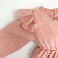 Load image into Gallery viewer, Pretty flutter shoulder details add extra style to this pretty girls romper, perfect for stylish baby girls and toddler girls. Long sleeves in a bautiful shade of pink. Also available in soft sage at Bel Bambini.