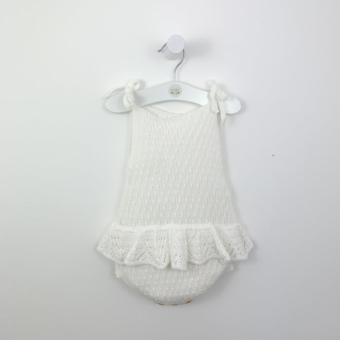 Girls summer romper. Delicately knitted in supersoft cotton, our white scallop knitted romper is perfect for the warm days as well as a great layering piece for  the colder days. Baby girl summer clothing. Baby rompers and toddler summer clothing exclusive to Bel bambini.