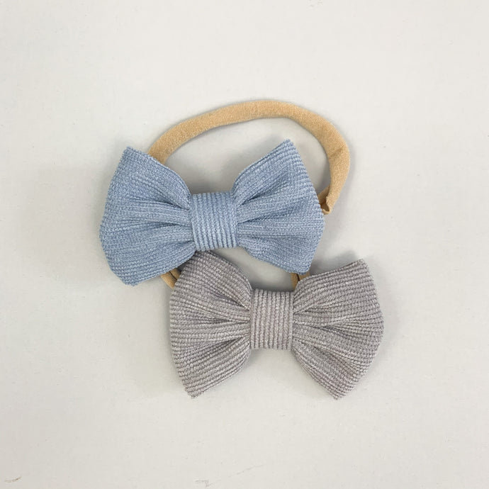 Babt girl headbands. Corduroy bows on an elasticated, super soft band available in a variety of colours.