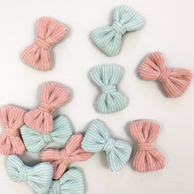 Load image into Gallery viewer, Creative photograph of our hair clips for girls, Pack of two available in baby blue and soft pink. Beautiful corduroy fabric makes these the most beautiful hair accessories for little girls. Exclusive to Bel Bambini accessories for toddlers and baby girls.