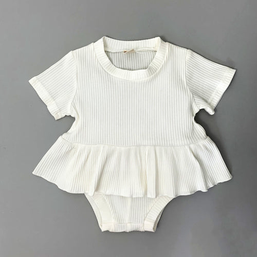 Summer baby outfit. Top and shorts for baby girl. This tunic top has short sleeves with a peplum frill hem, comes together with some sweet bllomers. A lightweight fabric thats perfect for summertime. Sweet baby girl clothes exclusive to Bel Bambini. Available in white.