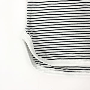 Striped tee with a stepped hem and contrast binding. A black and white summer set for toddler boys exclusive to Bel Bambini baby boutique.