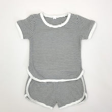 Load image into Gallery viewer, Our Boys shorts and T-shirt set in a black and white stripe. Contrast binding in white. Available in supersoft cotton, this is a perfect summer outfit for toddler boys up to 5 years old.