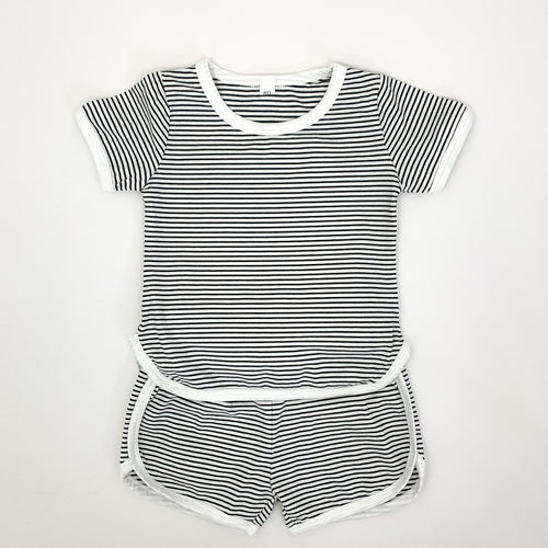 Our Boys shorts and T-shirt set in a black and white stripe. Contrast binding in white. Available in supersoft cotton, this is a perfect summer outfit for toddler boys up to 5 years old.