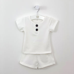 Baby boy shorts and t-shirt set in white, a perfect summer outfit made in a beautiful cotton rich supersoft and comfortable fabrication. Short sleeve tee and matching shorts with side pockets. A great outfit for casual and special events. Baby boy summer clothes and toddler summer outfits here at Bel Bambini baby boutique.