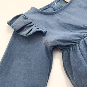 Detail shot of the flutter shoulder details. Rompers for girls 0-24 months.