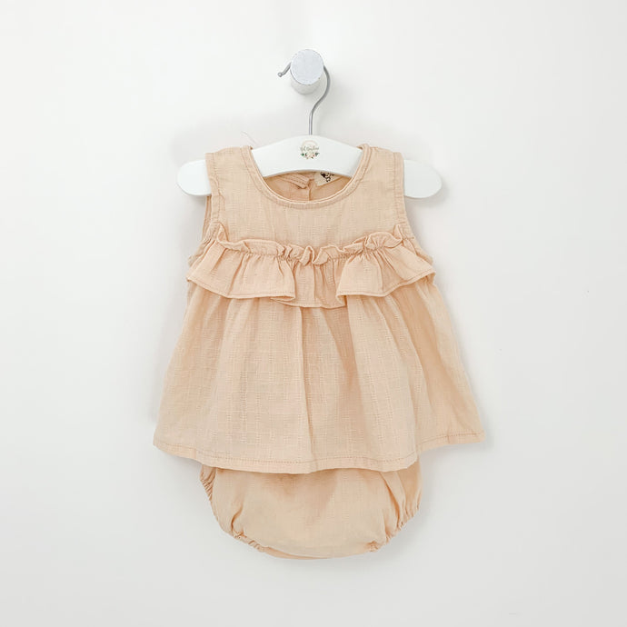 Baby girls summer outfit. A pretty top and bloomers set for girls in nude pink. Ruffles and frills make this a stylish summer set. sizes 0-2 years. Sleeveless top and ruffle bloomers for baby girls.