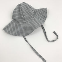 Load image into Gallery viewer, Baby boys summer hat in grey and white with two side straps for easy fastening under the chin if its breezy. Perfect baby boys outfit  at Bel Bambini baby boutique.