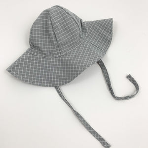 Baby boys summer hat in grey and white with two side straps for easy fastening under the chin if its breezy. Perfect baby boys outfit  at Bel Bambini baby boutique.