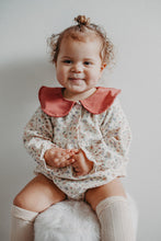 Load image into Gallery viewer, Baby modelling our spting romper in a beautiful floral print with a contrast statement collar.