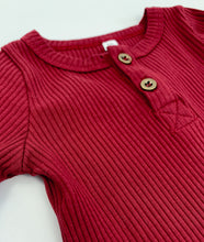 Load image into Gallery viewer, Ribbed vest in both berry and latte, two buttons to the top neckline with a round neck. Long sleeved layering essential vest for babies and toddlers. Popper fastenings at the bottom.