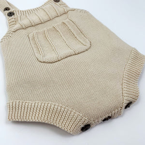 baby boys knitted romper with the cutest pocket pouch to the front..  Available in 0-18 months. Two button fastenings to the shoulder straps for an adjustable length. Baby boys clothing and toddler boys clothing online at Bel Bambini.