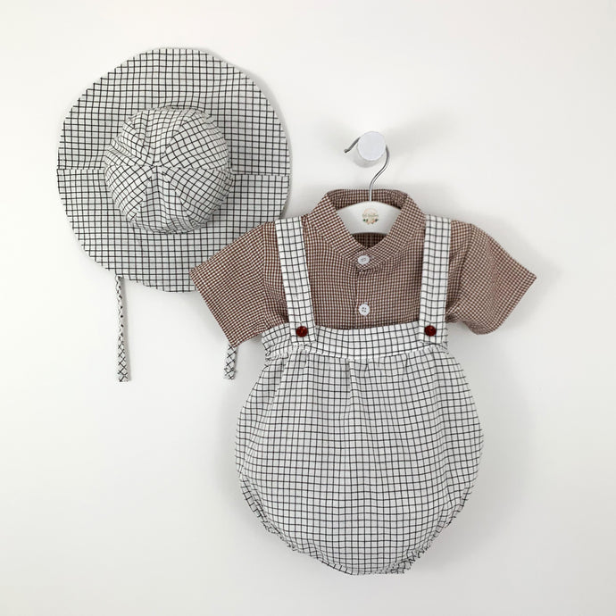 Baby boys plaid romper set with a matching hat. Three piece set, collarless shirt with short sleeves, dungaree style romper and hat. Baby boys party set. Adorable baby styles at Bel Bambini baby boutiquw.