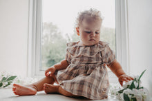 Load image into Gallery viewer, Baby girls romper dress in a neutral tartan print, Aun=tumnal hues and classic style make this girls romper dress extra special. Beautiful and super stylish. Team with rib knit tights from our collection of baby and toddler accessories.
