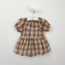 Load image into Gallery viewer, Baby girl romper dress in tartan. Neutral base with hues of pink and blue and a beautiful trim to the collar. Puff sleeves and a floaty A-line skirt to finish the overall stylish look.