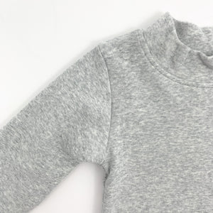 Grey marl sweater for baby boys with a high neck and long sleeves. 0-24 months clothing for boys at Bel Bambini boutique.