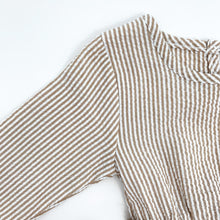 Load image into Gallery viewer, Detail showing our baby girls stripe print romper in neutral. Textured fabric base and long sleeves. Perfect to layer up for the colder days. Autumn, winter romper.