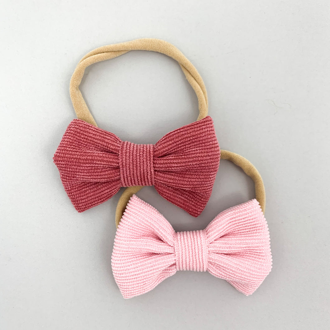 Baby and toddler bow headbands come in a pack of two. Available in a variety opf colour options. Supersoft band and so stylish. Shop our baby and toddler collections online.