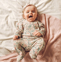 Load image into Gallery viewer, Baby girl in our gorgeous vintage floral baby grow. Great sleepsuit with pink bow details. Such a pretty baby grow.