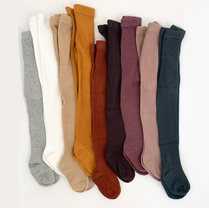 Ribbed tights for baby girls 0-2 years. Soft and comfortable rib knit tights in an array of 9 different colours. Tights for baby girls and tights for toddler girls. Warm rib knitted tights.