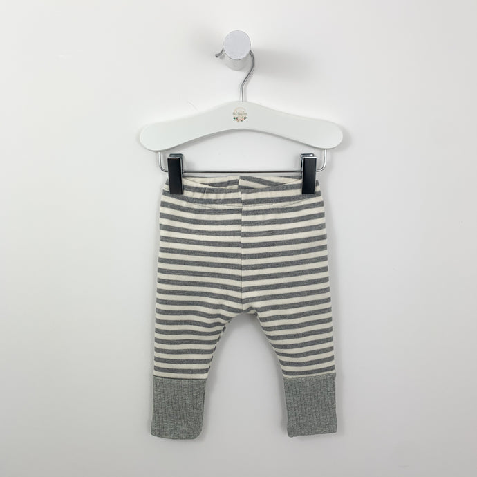 Grey striped leggings for baby and toddler boys 0-2 years. Super soft and comfortable, rib cuff in grey to the bottom of the leg. These leggings are for everyday wear for little ones and for for rolling around in with the soft and stretchy fabric base. Elasticated waistband for an extra comfortable fit