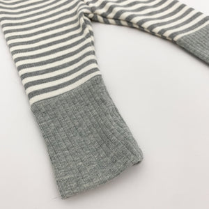 Detail shot showing the contrast grey rib cuff to the bottom of out comfortable baby boys striped leggings in grey. Available in 0-2 years at Bel Bambini Baby Boutique. Shop our collections for baby boys 0-2 years online.