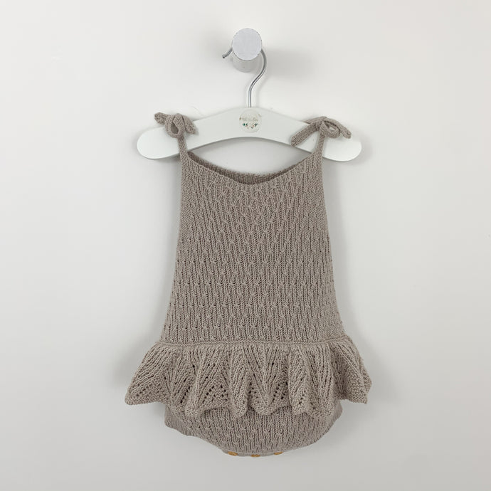 Delicate knitted infant romper. Beatifully stitched with a scallop frill to the waist. Preety knitted romper for girls available in taupe and mauve/ pink. 0-2 years.