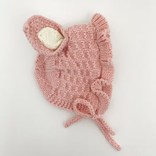 Load image into Gallery viewer, Pink bunny ear knitted hat for baby girls, bonnett style knitted hat with a tie to the front and a frill trim. Pink with cream ears and inner fleece.