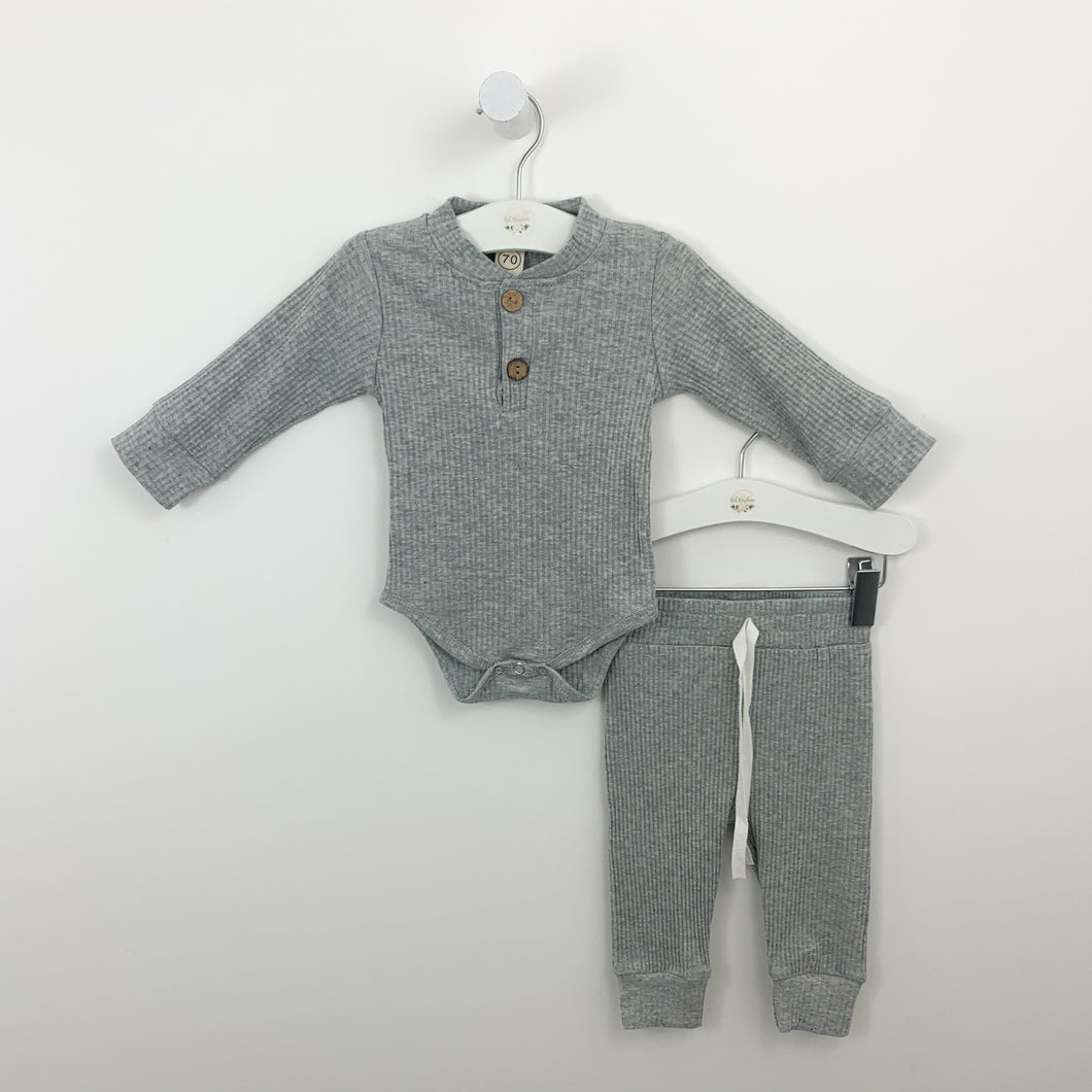 Boys lounge set in tan or grey marl. Perfect for playing and relaxing. Ribbed set with a long sleeved vest and matching pants. Baby boys and toddler boys  comfortable lounge set.