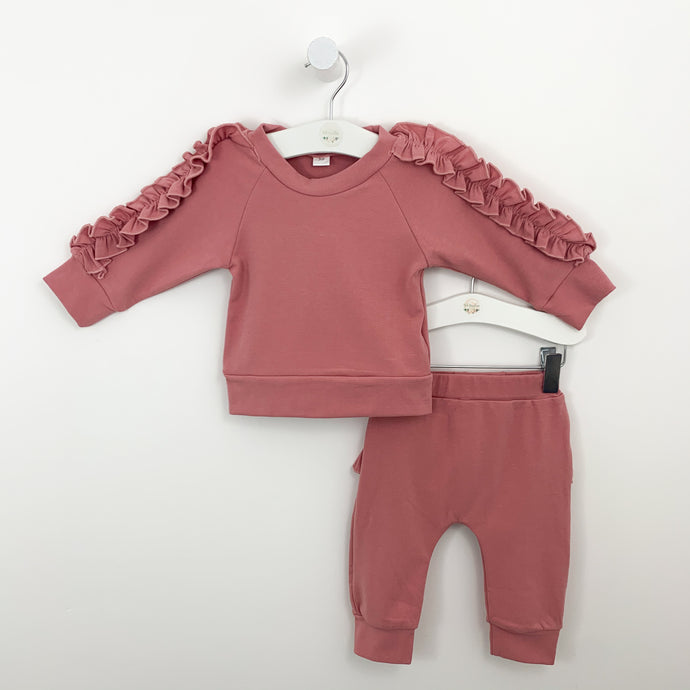 Baby girls lounge set in deep pink. Frill trims to the arms and bottoms. Long sleeves matching two piece loungewear set for babies and toddlers, exclusively at Bel Bambini boutique.