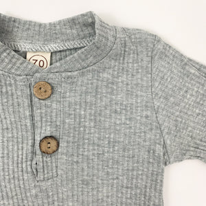 Ribbed loungewear set for baby boys up to 24 months. Available in tan or grey marl. Long sleeved set that's comfortable and soft.