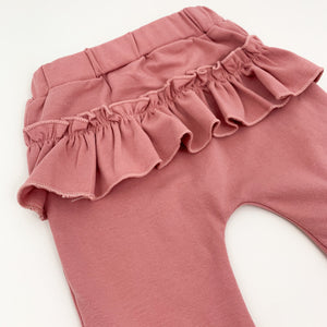 Frill trim to the back on the loungewear bottoms for babies and toddler girls. Matching set in deep pink.