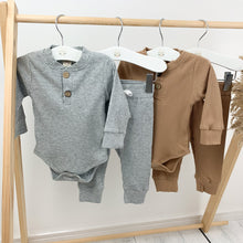 Load image into Gallery viewer, Our loungewear sets are so comfortable for boys 0-2 years old. Long sleeves and super cute. Grey marl lounge set or tan lounge sets are available at Bel Bambini baby clothing boutique.