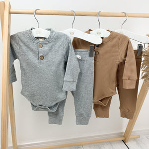 Our loungewear sets are so comfortable for boys 0-2 years old. Long sleeves and super cute. Grey marl lounge set or tan lounge sets are available at Bel Bambini baby clothing boutique.
