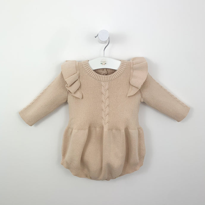 knitted romper in a beautiful natural tone. Flutter shoulder detailing and long sleeves. Cable knit design, super soft and  comfortable in sizes 0-2 years.