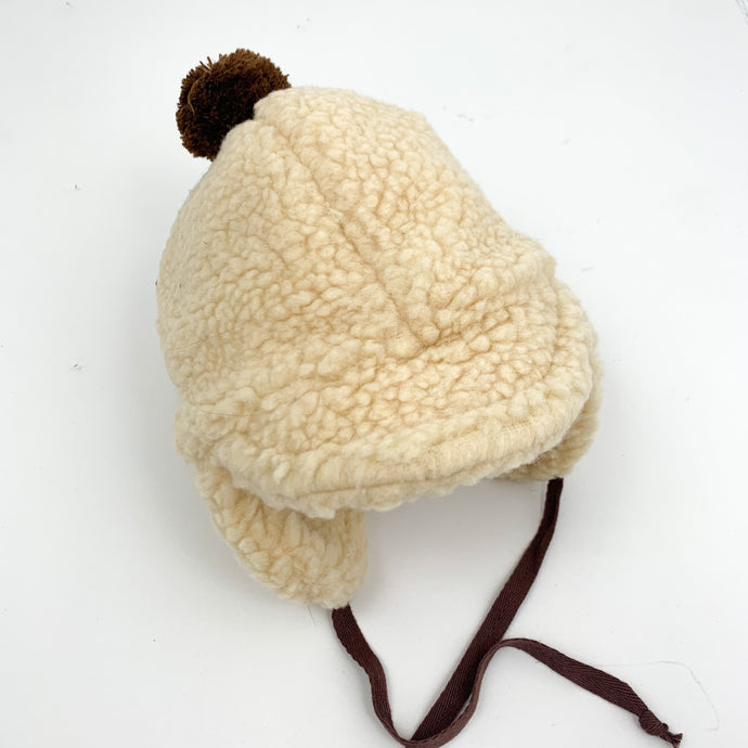Baby boys bobble hat with ear covers in a warm and cosy teddy bear fleece, drawsting tie under the chin.  Available in beige or coffee 0-2 years.