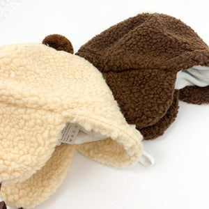 Baby boys teddy bobble hat with ear covers to keep extra warm.
