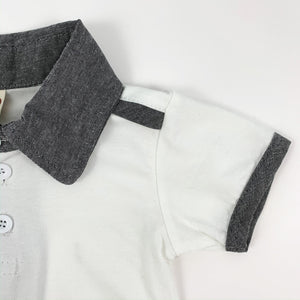 Baby and toddler tee to match the cute dungarees that they come with. Contrast binding on the short sleeve tee, with a contrast collar and stripe to the shoulder. Such a stylish set for little boys to wear.