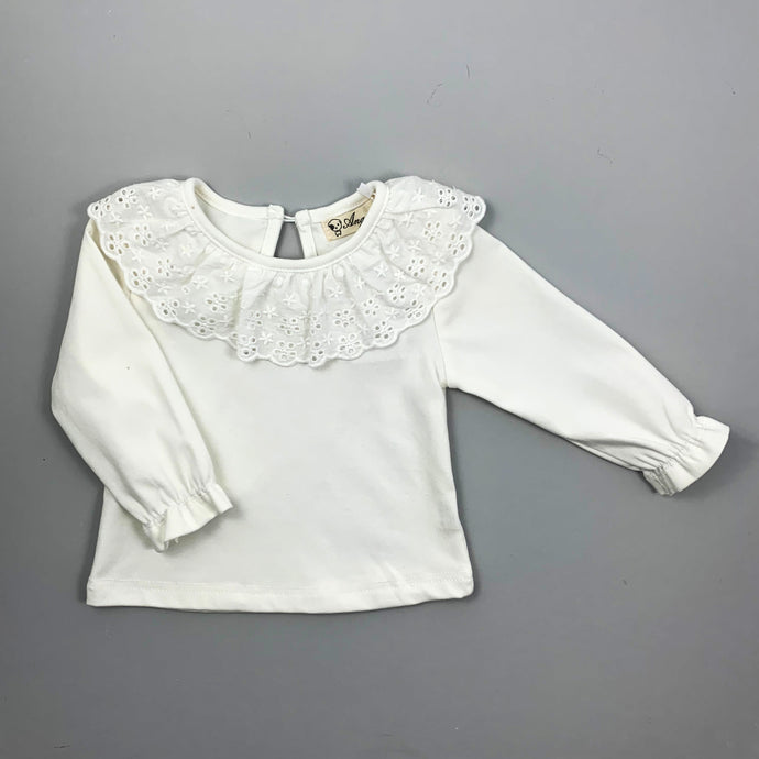 Toddler Long sleeved super soft blouse, sleeve cuffs have a flutter edge finish. A beautiful broderie anglaise lace trim to the neckling make this top so pretty and perfect to layer underneath dresses and rompers or wear with leggings, skirt or bottoms. Such a versatile top that can be dressed up or down.