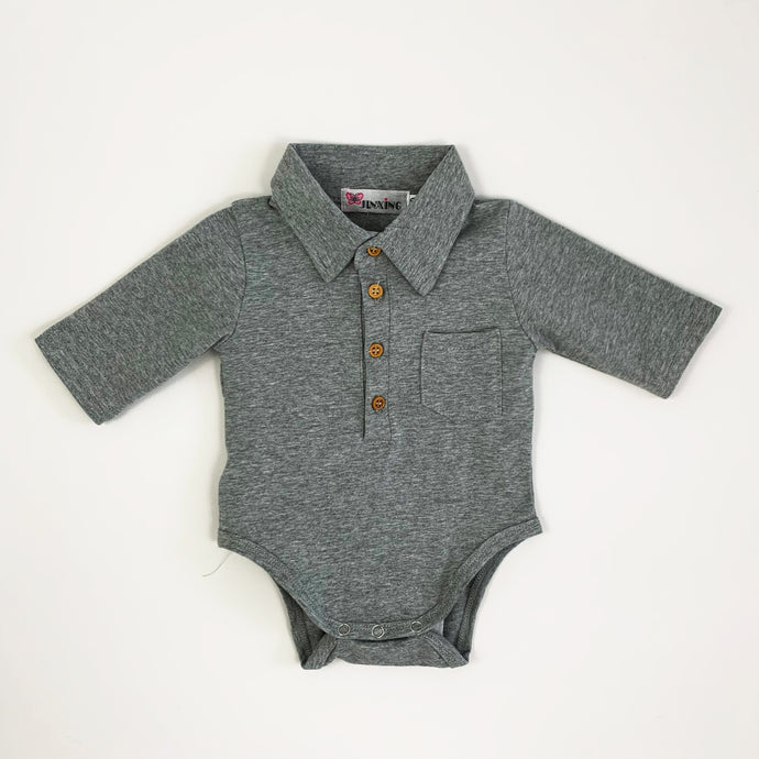 Baby boy shirt, collar to the neck with buttons down the front chest and a pocket detail. Long sleeve boys shirt in a vest style for easy comfort.