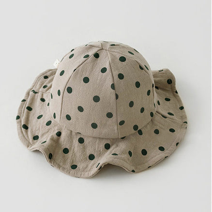 Baby boys floppy sunhats. Perfect polka dot printed sunhats in neutral shades for boys and girls aged 0-2 years. Floppy sunhats for girls. Protect your little ones face from the sun with our cotton sunhats for babies and toddlers up to 2 years old.