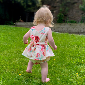 Beautiful floral print romper for girls, sleeveless with a peplum skirt and bow tie back. Beautiful for special occasions.