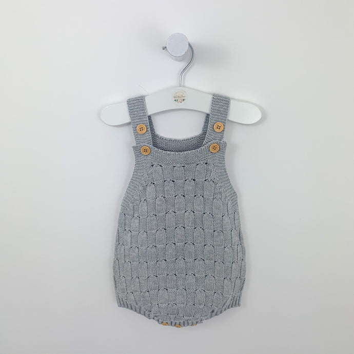 Grey knitted romper for baby boys. Our weave knit romper is so adorable. There are button fastenings to the shoulder straps and bottom of the romper. Baby boys knitted rompers and stylish baby clothing for boys 0-3 years.