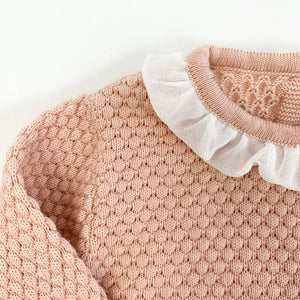 Detail shot of our Bel Bambini two piece knitted set in shell pink. Stunning girls outfit.